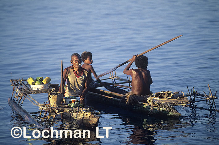 Milne Bay Province – Trobriand Island – men in traditional canoes