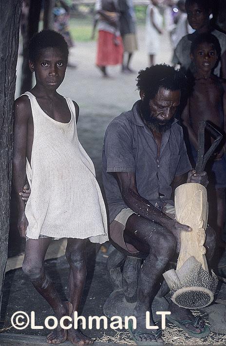 Milne Bay Province – making a Kundu drum